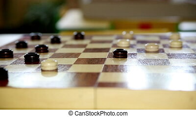 Children Playing Checkers at The Table. Age 5 Years