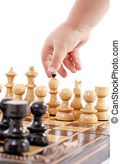 Children playing chess - Childre hand with chess, isolated...