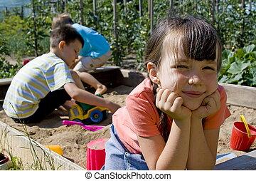 Children playing - Children in sand-box