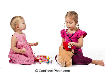 Children playing doctor with a doll
