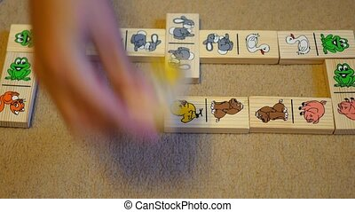 children playing dominoes - the children put a chain of...