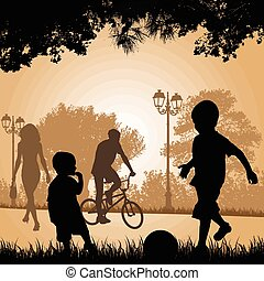 Children playing in a city park at sunset