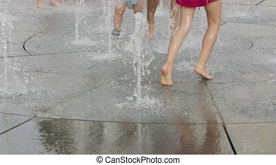 Children Playing in a Fountain. - Children playing in a...
