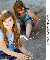 Children Playing in a Sand Park