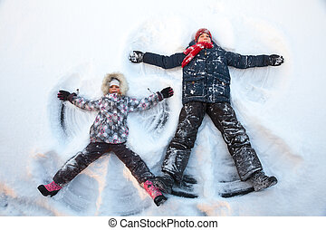 Children playing in a snow enjoying winter
