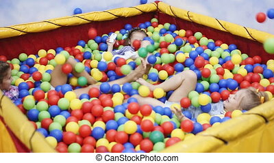 children playing in ball pool - kids playing in ball pool