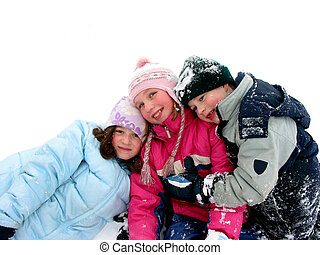 Three children having fun in the fresh white snow