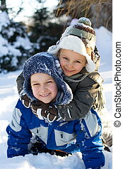 Children Playing In Snow - Two young brothers embracing...