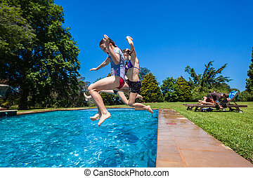 Children Playing In Swimming Pool Outdoors Summer
