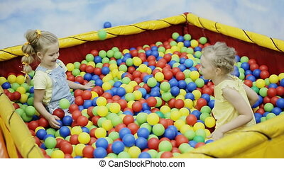 children playing in the ball pool