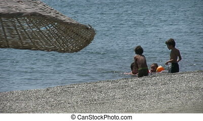 Children playing in the sea