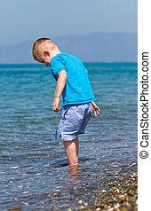 children playing on hot beach