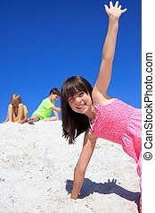 Children playing on sand