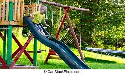 children playing on slide in park