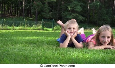 children playing on the grass - two children playing on the...