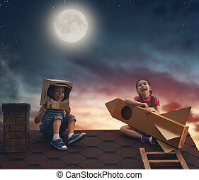 children playing on the roof - Two little children playing...