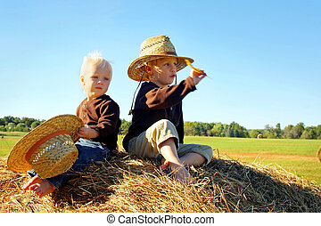 Children Playing Outside on Hay Bale