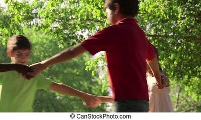 Children playing ring around rosie