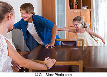 children playing romp game - Happy brother and small sister ...