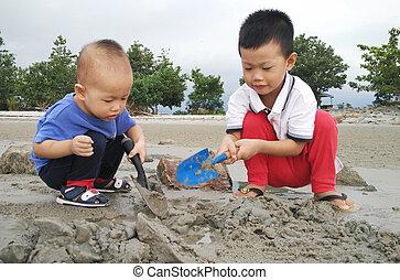 Children playing sand at beach