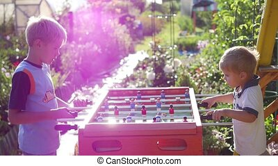 children playing table football outdoors. Fun outdoors