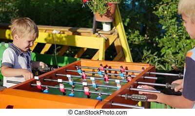 children playing table football outdoors.Fun outdoors