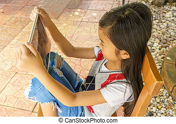Children playing tablet