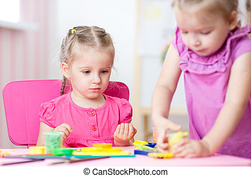children playing together in nursery