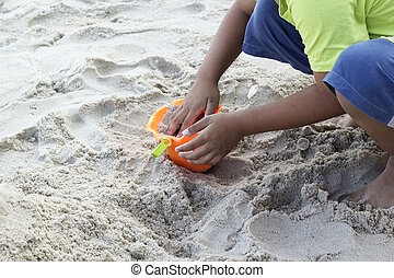 Children playing toy on sand