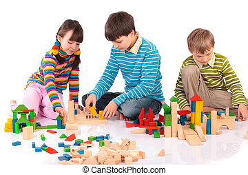 Children playing with blocks - Young children playing with...