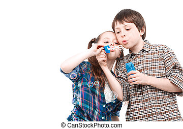 Children playing with bubble blower