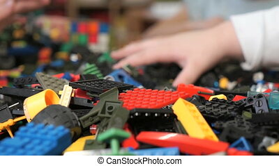 Children playing with building kit. Close-up - Close-up of...