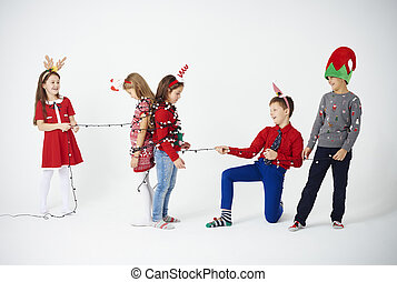 Children playing with christmas light