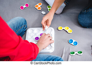 Children playing with colorful toy