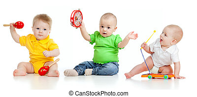 Children playing with musical toys. Isolated on white...