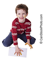 Children playing with paint, stamping his hand on a white sheet