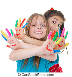 children playing with paint - happy smiling children playing...