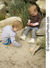 Children playing with sand on a beach