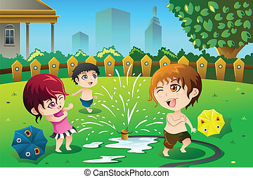 Children playing with sprinkler water in the summer