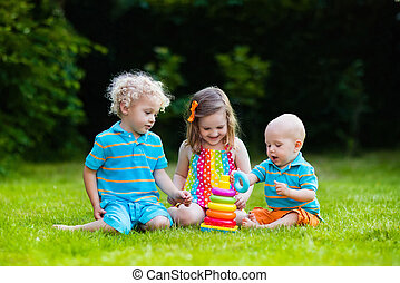 Children playing with toy pyramid