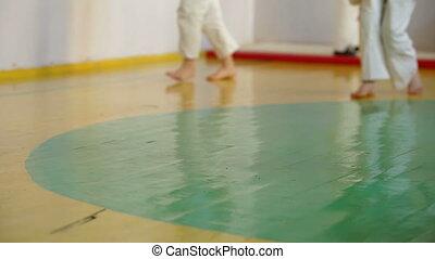 Children practice karate