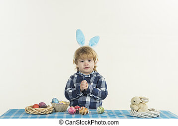 Children prayer for Easter, faith and hope for the future. Religion and culture, prayer for the holiday. Handsome little boy praying. Easter background, happy holidays with family traditions