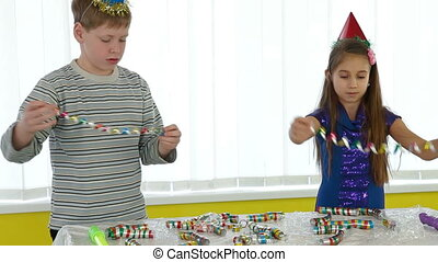 Children preparing decoration for birthday party