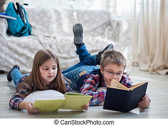 Children readind book in living room
