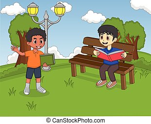 Children reading a book in the park