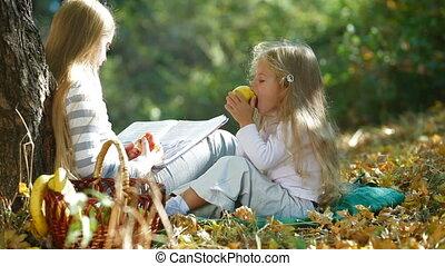 Children Reading Book In The Autumn