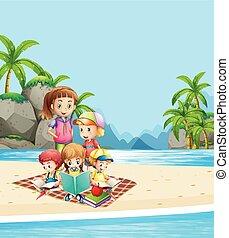 Children reading books on the beach