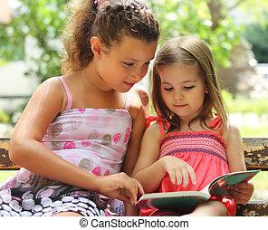 Children reading the book