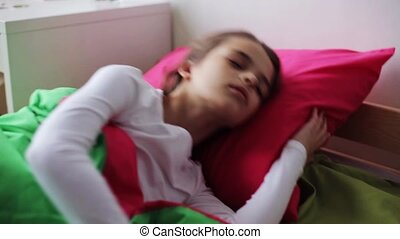 girl sleeping in her bed at home