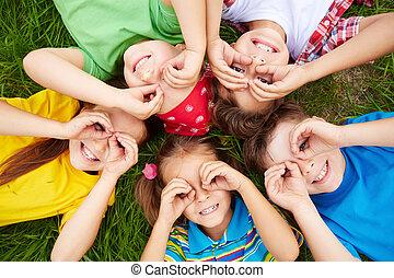 Children resting  - Group of cute children lying on grass